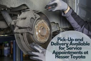 Technician working on brakes with Pick-Up and Delivery Available for Service Appointments at Hesser Toyota text