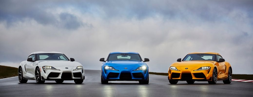 Three 2021 Toyota Supra models side by side on track