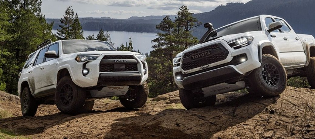2020 Toyota 4Runner TRD Pro and Tacoma TRD Pro parked on rock