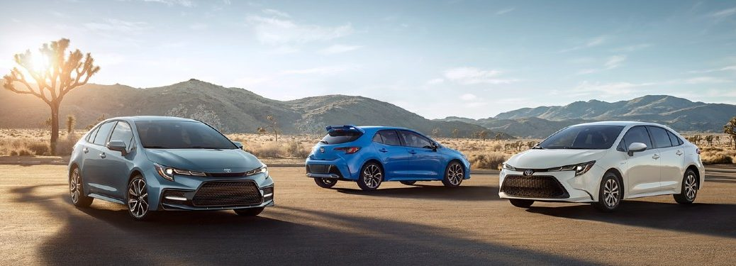 Three 2021 Toyota Corolla models parked side by side in desert
