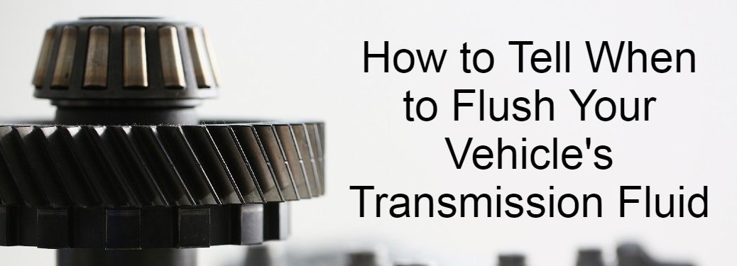 Closeup of transmission with text saying _How to tell when to flush your vehicle's transmission fluid