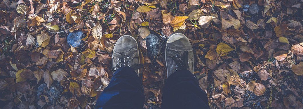 Boots on fallen leaves