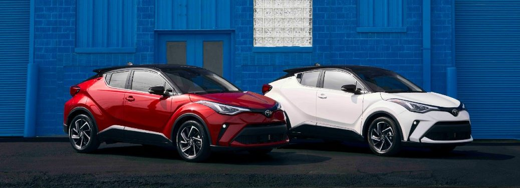 2021 Toyota C-HR models in front of blue brick wall
