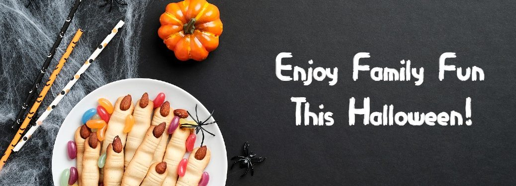 Photo of spooky Halloween table with _Enjoy Family Fun this Halloween!