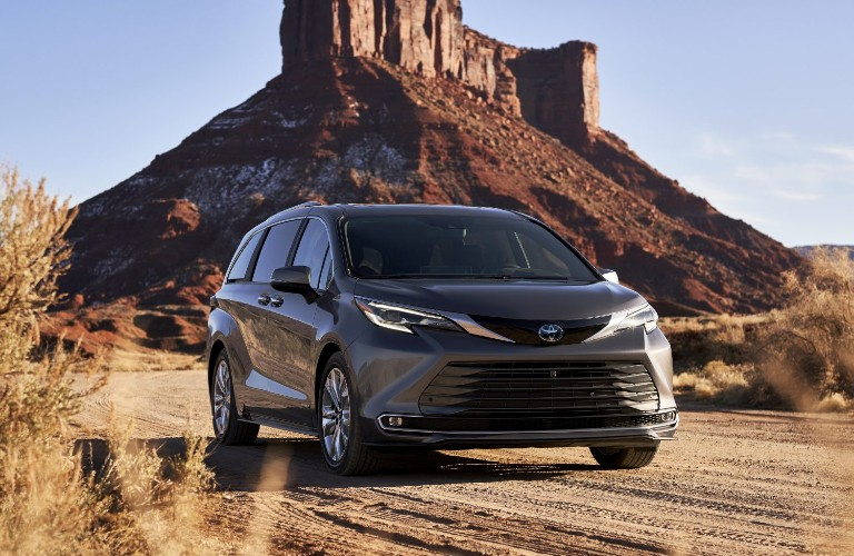 2021 Toyota Sienna in front of a rock