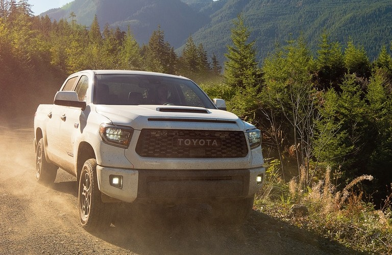 2021 Toyota Tundra driving on a dirt road