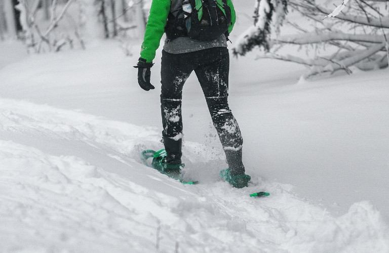 Person snowshoeing in deep snow