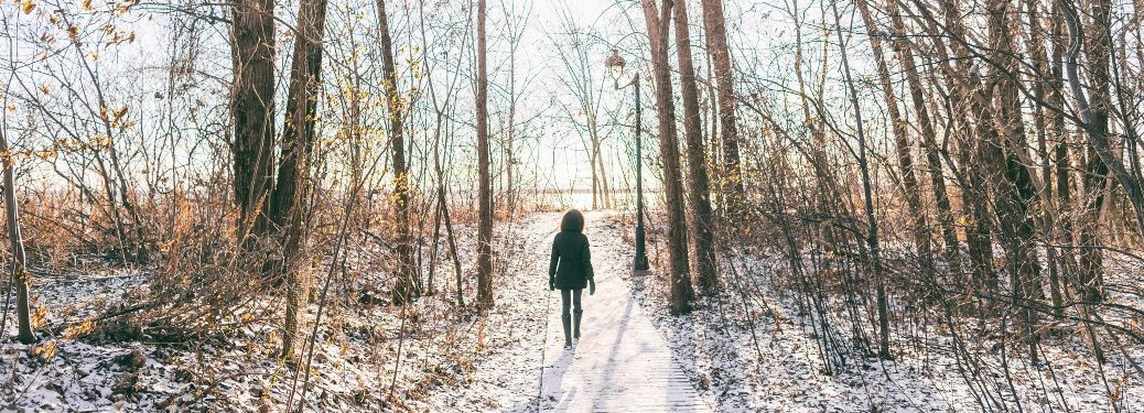 Person walking on path in winter