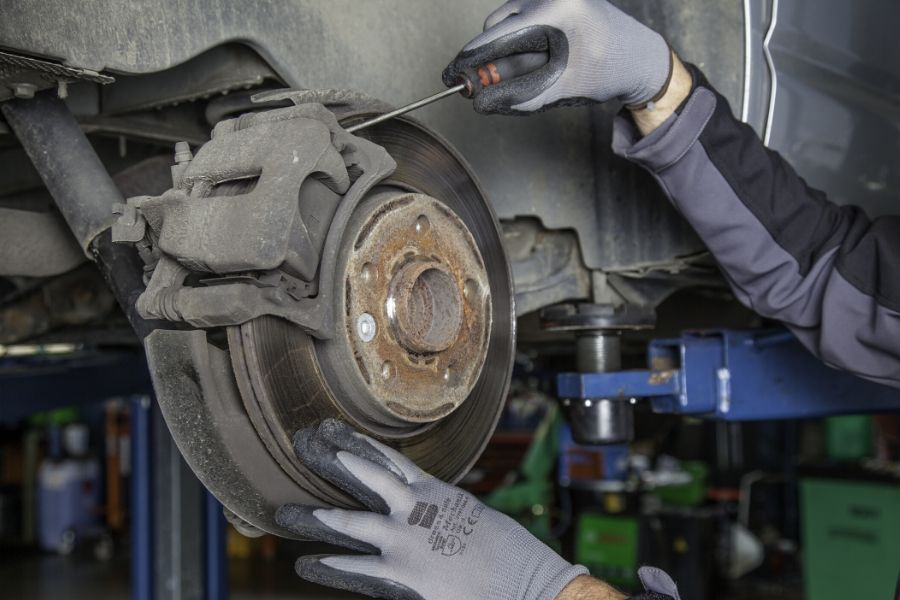 Mechanic working on a car's brakes