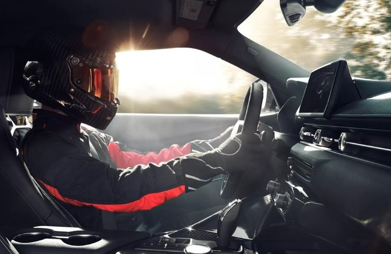 man in racing suit driving the 2022 Toyota GR Supra
