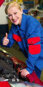 Blonde Female Mechanic Giving the Thumbs Up When looking Under the Hood of a Car
