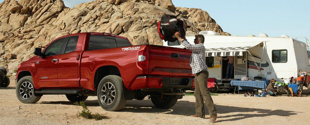 Red 2016 Toyota Tundra with Camper and Camping Gear