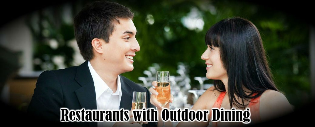Young Couple Dining Outdoors with Champagne