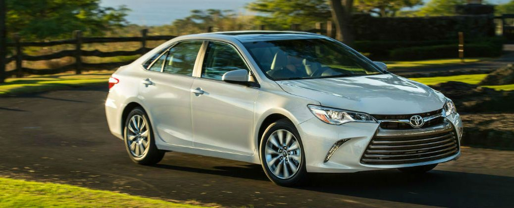 White 2017 Toyota Camry XLE on Country Road