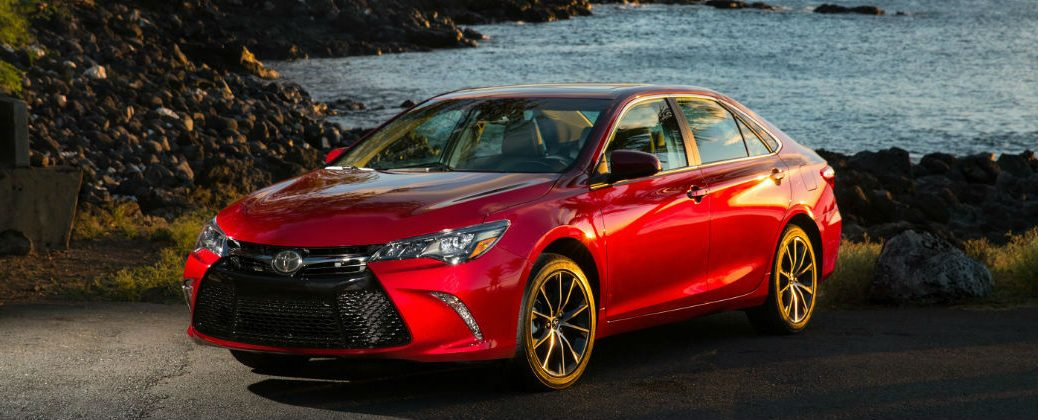 Red 2017 Toyota Camry at the Beach