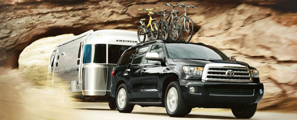 Black 2016 Toyota Sequoia with Bike Rack Towing Trailer