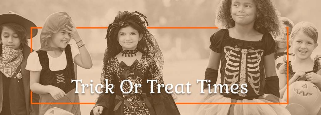 Little Kids Trick or Treating on Halloween in Costume