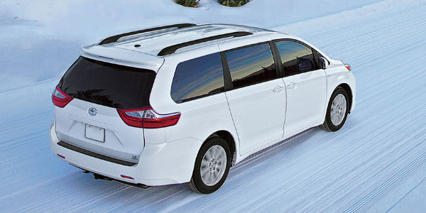 White 2017 Toyota Sienna with All-Wheel Drive on Snow