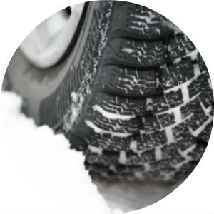 Close Up of Snow Tires in Snow