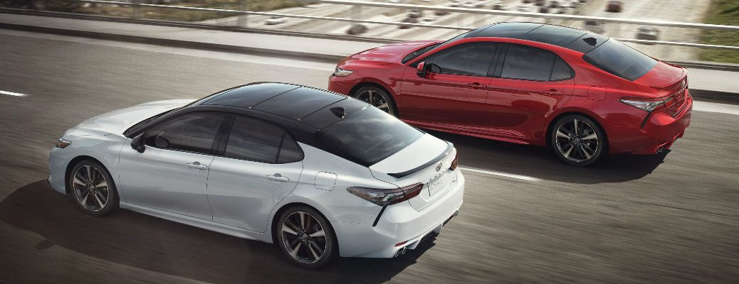 White and Red 2018 Toyota Camry XSE Models on the Freeway with Panoramic Moonroof