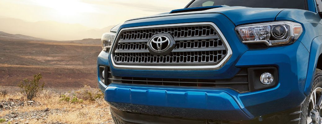 Close Up of Blue 2017 Toyota Tacoma Front Exterior and Grille with Toyota Logo