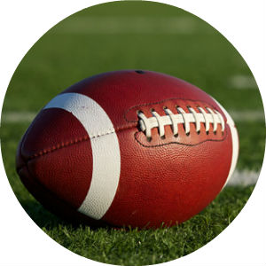 Close Up of Football on Green Field