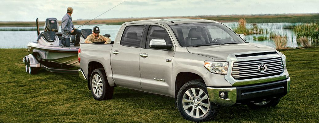 Silver 2017 Toyota Tundra Towing a Boat Out of the Water