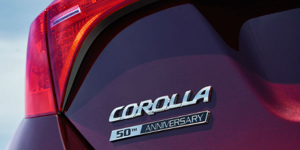Close Up of 2017 Toyota Corolla 50th Anniversary edition Badge with Black Cherry pearl Exterior