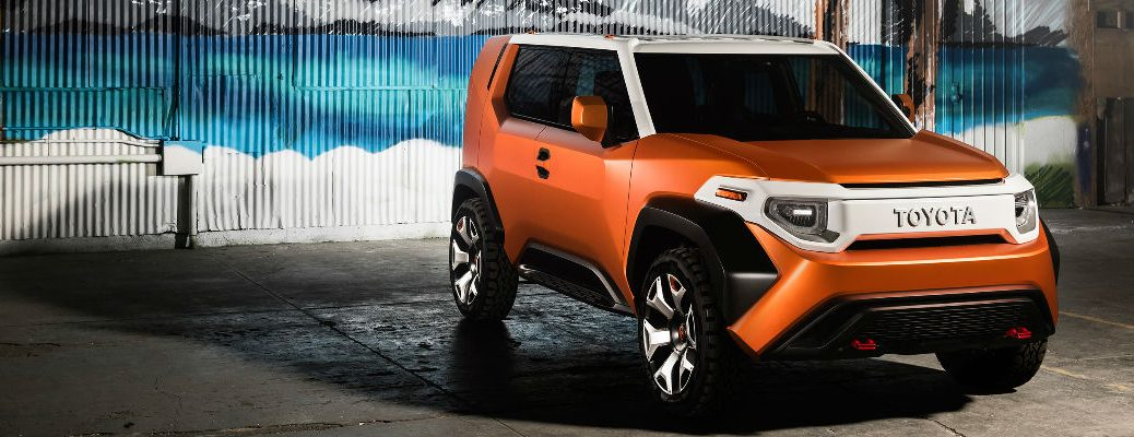 Orange and White Toyota FT-4X Concept in Front of a Beach Mural