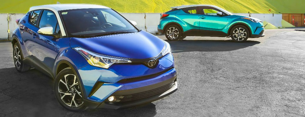 Blue Eclipse Metallic and Radiant Green Mica R-Code 2018 Toyota C-HR Models in Parking Lot