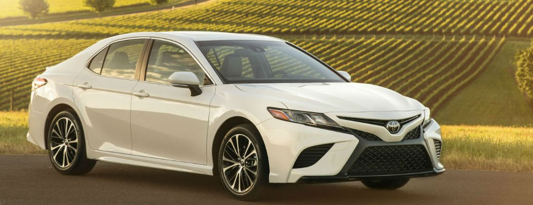 White 2018 Toyota Camry Front and Side Exterior with Vineyard in Background