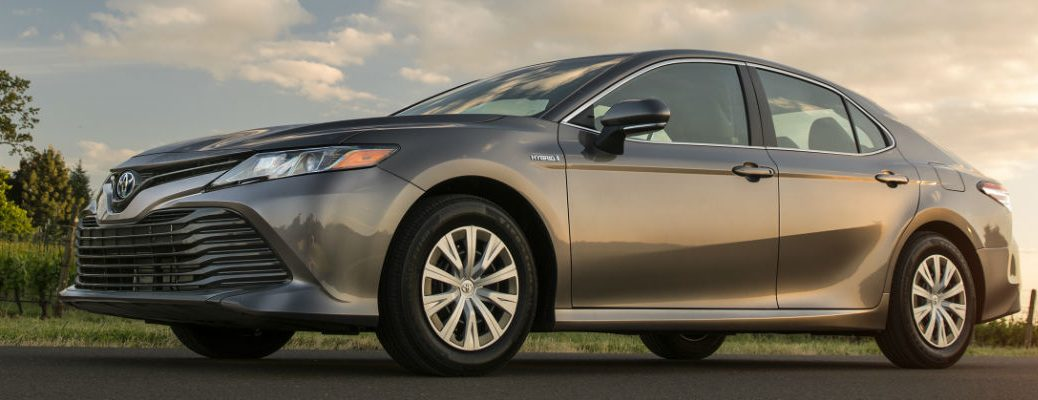 Gray 2018 Toyota Camry Hybrid Front and Side Exterior from low angle