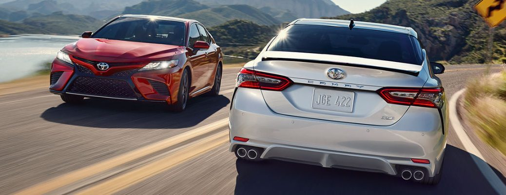 Red and Silver 2018 Toyota Camry Models on Curvy Road