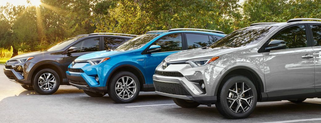 3 2018 Toyota RAV4s in Parking Lot in Silver Sky Metallic, Electric Storm blue and Magnetic Gray Metallic