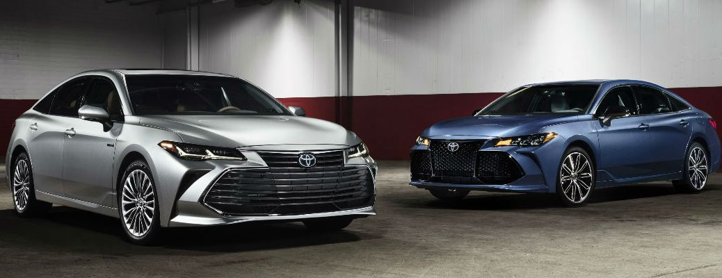 Silver and Blue 2019 Toyota Avalon Models Parked in Indoor Parking Structure