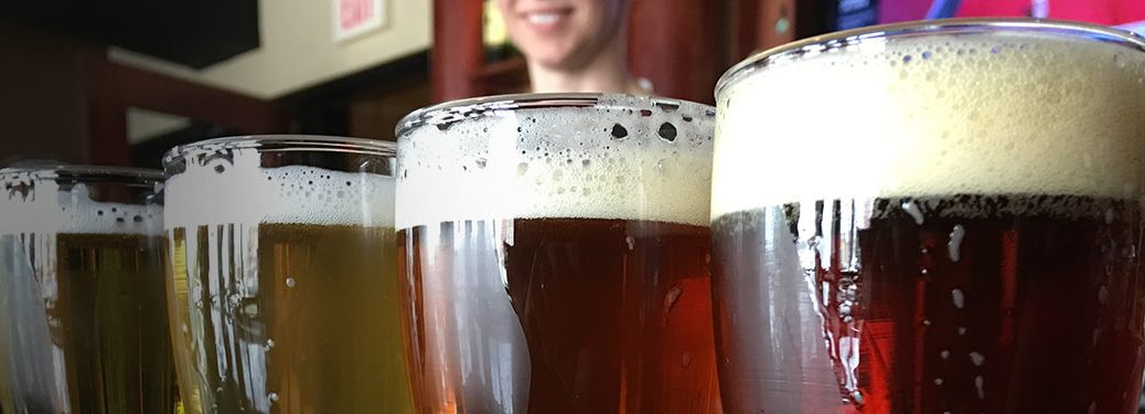 Close Up of Full Pint Glasses on a Bar