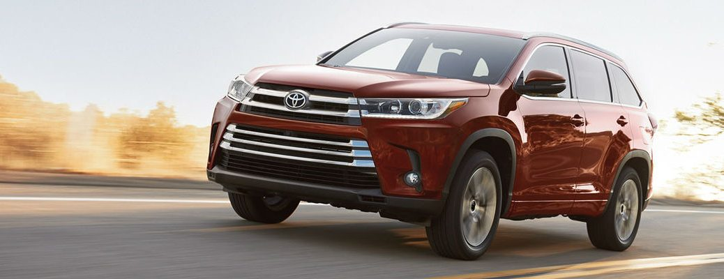 Ooh La La Rouge Mica 2018 Toyota Highlander Driving on a Country Highway