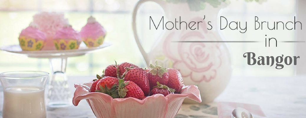 Table with Milk, Cupcakes and Strawberries and Black Mother's Day Brunch in Bangor Text