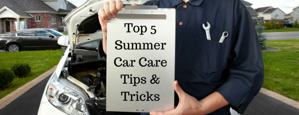 Mechanic Standing in Front of White Car Holding a Clipboard with Top 5 Summer Car Care Tips & Tricks Text