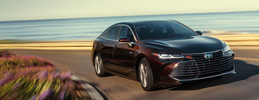 Maroon 2019 Toyota Avalon Limited Driving on a Coast Road