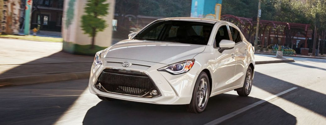 White 2019 Toyota Yaris Sedan Driving on a City Street