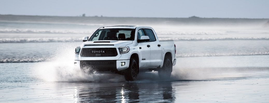 Super White 2019 Toyota Tundra TRD Pro Driving Through the Waves on a Beach
