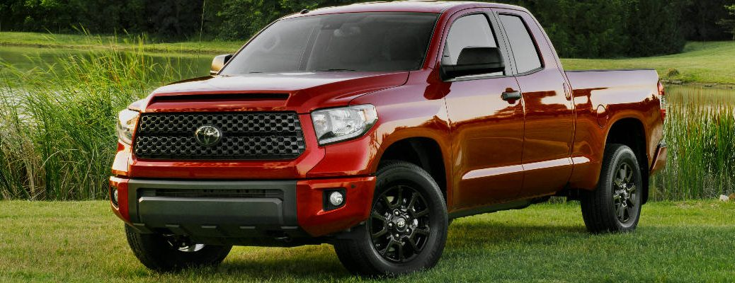 Red 2019 Toyota Tundra SX Package Front and Side Exterior on Grass Next to a Pond