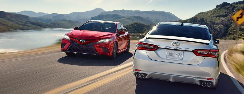 Red and Silver 2019 Toyota Camry Models on a Coast Road