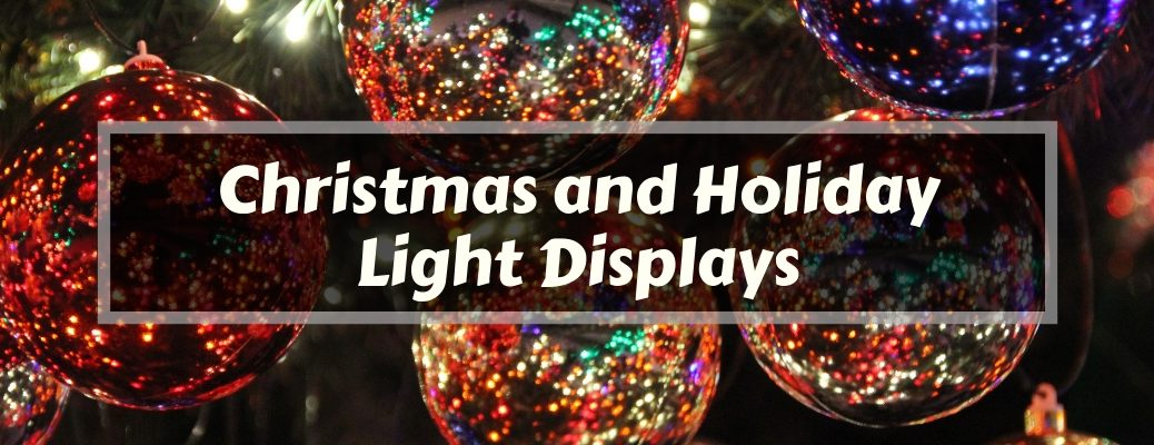 Close Up of Ornaments on a Lit Christmas Tree with White Christmas and Holiday Light Displays Text