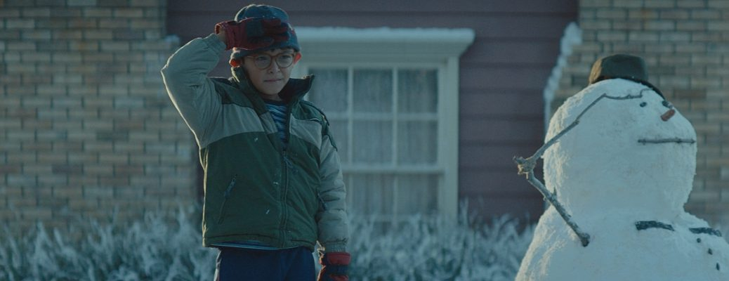 Young Boy Saluting Next to Snowman Saluting in Toyotathon Home for the Holidays Ad