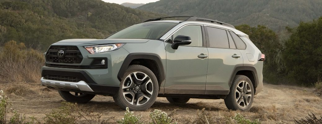 Gray 2019 Toyota RAV4 Climbing a Dirt Trail