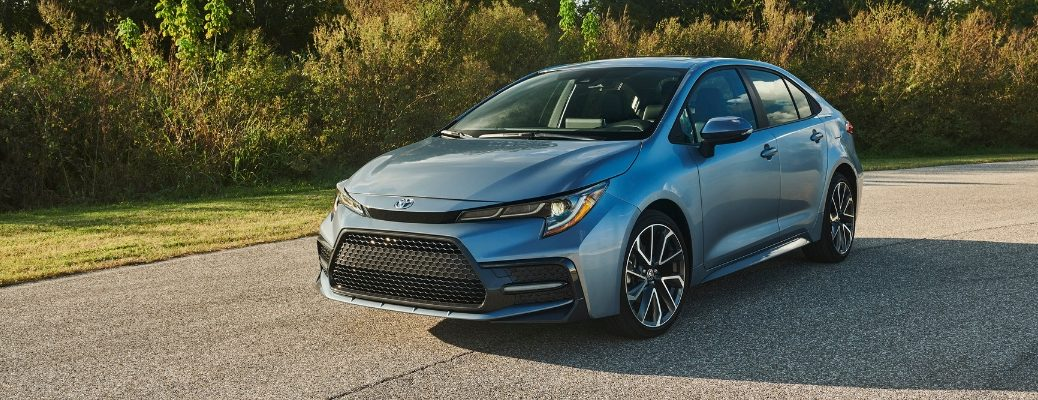 Blue 2020 Toyota Corolla Front Exterior Driving on a Country Road