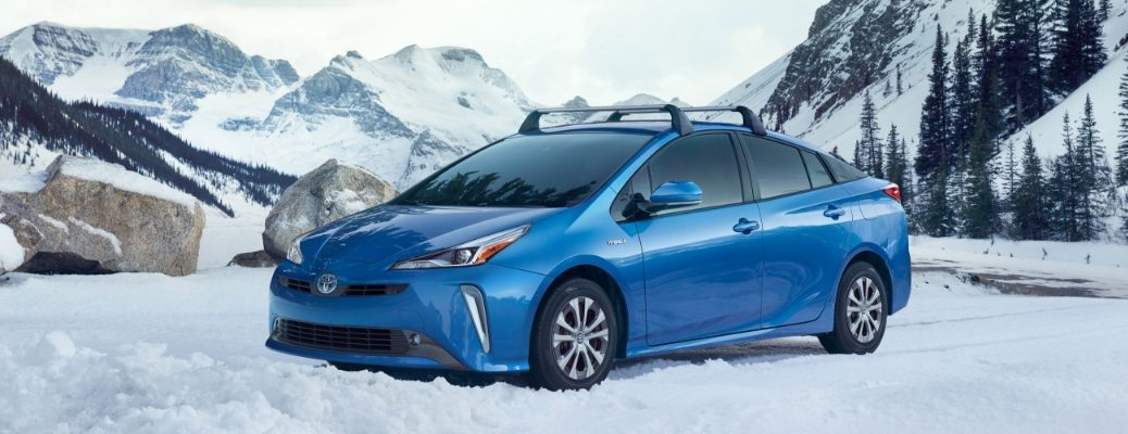 Blue 2019 Toyota Prius Side Exterior on Snowy Mountain Road