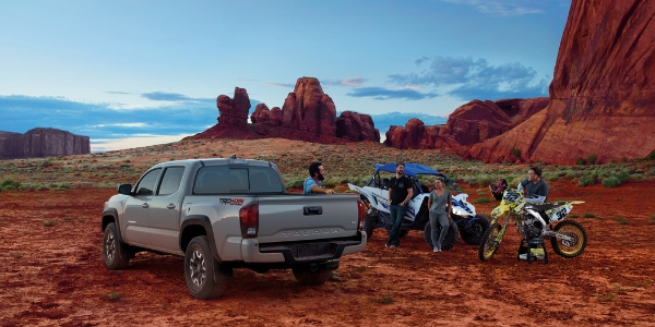 Gray 2019 Toyota Tacoma in the Desert with ATVs and People